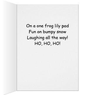 Cartão Sapo que precipita através da neve em uma almofada