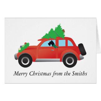 Cartão Schnauzer gigante que conduz o carro com árvore de