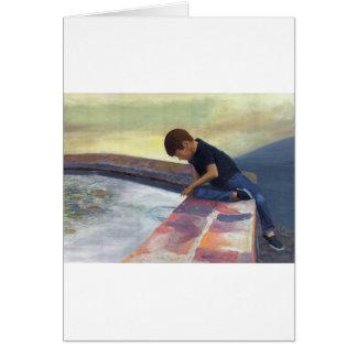 Cartão Seixos deixando cair do menino