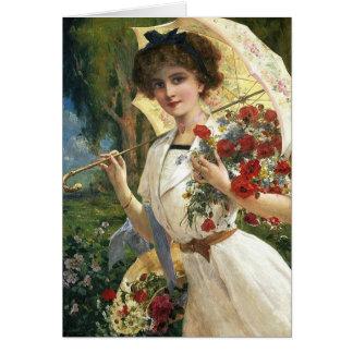 Cartão Senhora do vintage com parasol em um jardim,