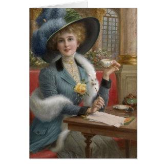Cartão Senhora do vintage em uma mesa de escrita,