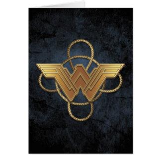 Cartão Símbolo do ouro da mulher maravilha sobre o laço