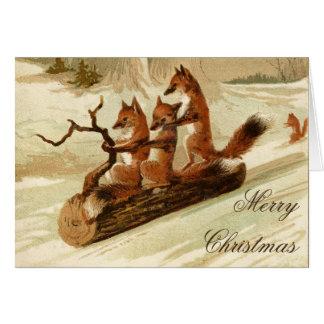 Cartão Sledding do Feliz Natal do vintage das
