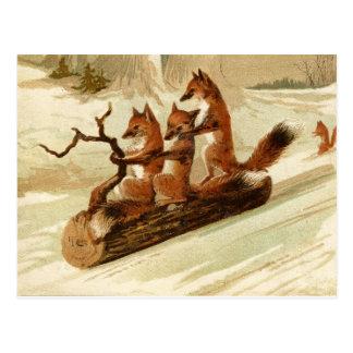 Cartão Sledding do natal vintage das raposas