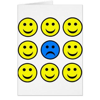 Cartão Smiley face triste em uma multidão de Smilies