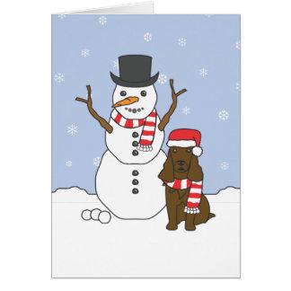 Cartão Spaniel e boneco de neve de campo
