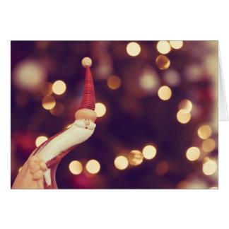 Cartão Stoping perto para desejar o Feliz Natal