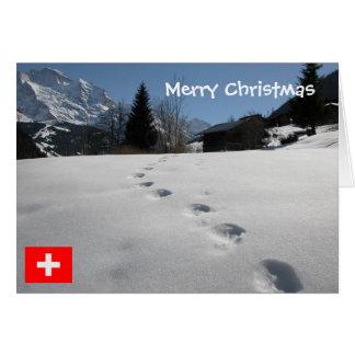 Cartão Suiça, pegadas na neve