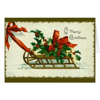 Cartão Trenó 1907 do Natal do vintage com azevinho