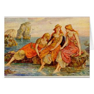 Cartão Três mulheres que refrigeram seus pés no mar,