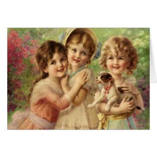 Cartão Trio das meninas com filhote de cachorro,