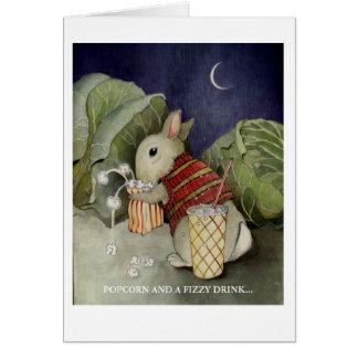 Cartão Um coelho aprecia um petisco
