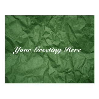 Cartão vazio amarrotado da textura do papel verde