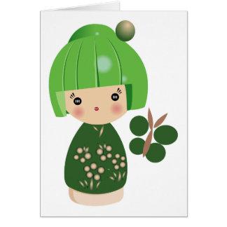 Cartão verde da objectiva tripla de Kokeshi