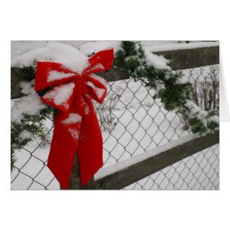 Cartão vermelho do arco do Natal