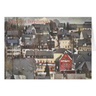 Cartão Vila do inverno com Feliz Natal vermelho de uma