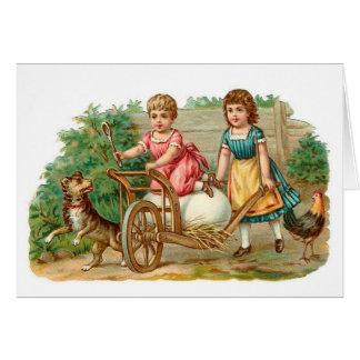Cartão Vintage do carrinho de mão do ovo da páscoa