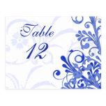 Cartões florais azuis e brancos da mesa do cartão postal