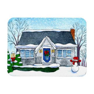 Casa bonito do Natal com ímã do boneco de neve
