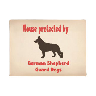 Casa protegida por cães de guarda do german tapete