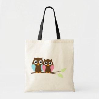 Casal da coruja em um ramo bolsa de lona