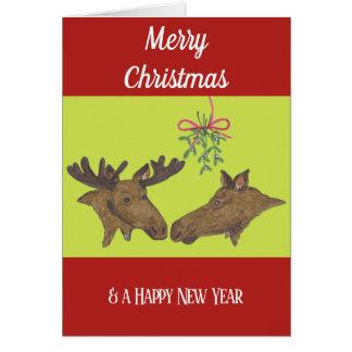 Casal e visco dos alces do cartão de Natal