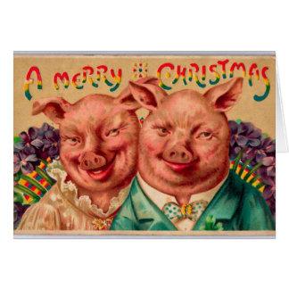 Casal impar do porco do cartão de Natal do casal!
