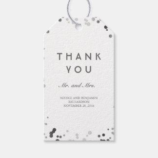 Casamento elegante dos confetes de prata e brancos etiqueta para presente