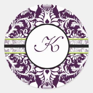 Casamento roxo da letra K da etiqueta da inicial