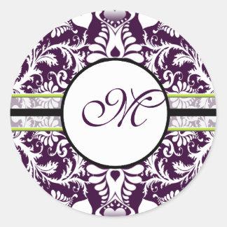 Casamento roxo da letra M da etiqueta da inicial