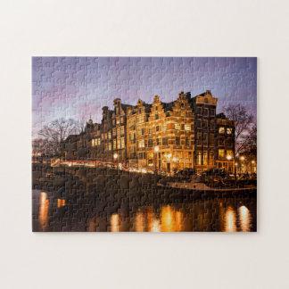 Casas do canal de Amsterdão no quebra-cabeça de