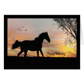 Cavalo da silhueta com o cartão de aniversário do