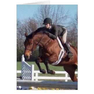 Cavalos e cartão de salto da mostra