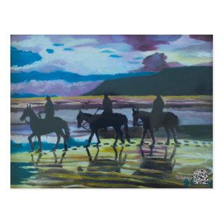 Cavalos na praia de Waterfoot pelo cartão de