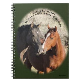 Cavalos selvagens do caderno da bacia de lavagem
