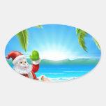 Cena da praia do papai noel do Natal do verão Adesivos Oval