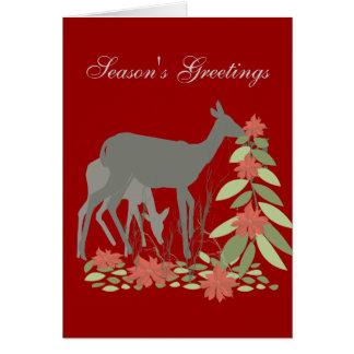 Cervos com árvore da poinsétia cartão comemorativo