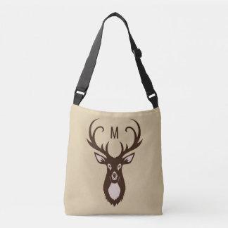 Cervos com suas bolsas do costume do monograma