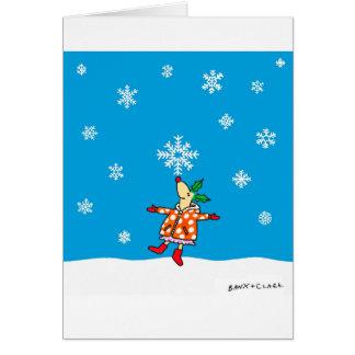 Cervos do azevinho com o cartão do Xmas dos flocos