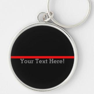 Chaveiro A linha vermelha fina simbólica seu texto no preto
