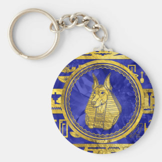 Chaveiro Anubis dourado com hieroglyphs no azul