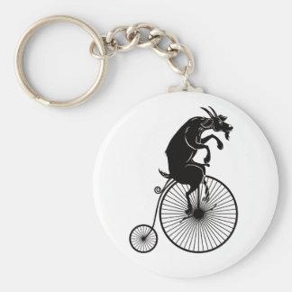 Chaveiro Cabra que monta uma bicicleta do Farthing da moeda