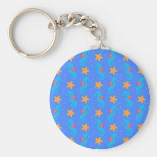 Chaveiro Cavalos marinhos e teste padrão azuis da estrela