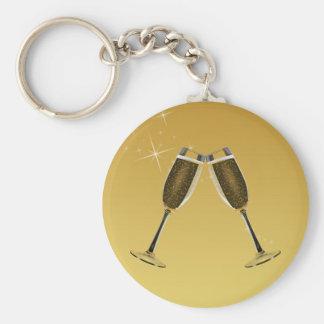 Chaveiro Celebração dos vidros de Champagne no ouro