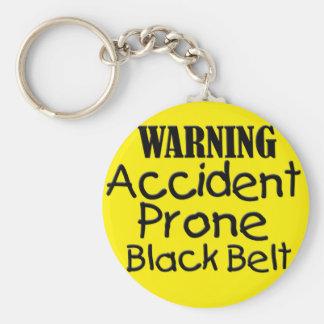 Chaveiro Cinturão negro propenso a los accidentes de