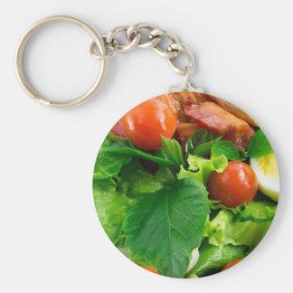 Chaveiro Detalhe de uma placa com tomates de cereja, ervas