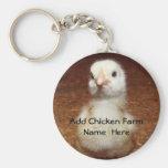 Chaveiro do fazendeiro da galinha com pintinho do