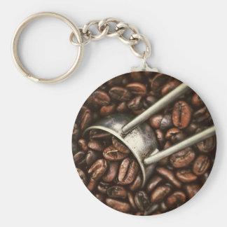 Chaveiro Feijões de café e colher do metal