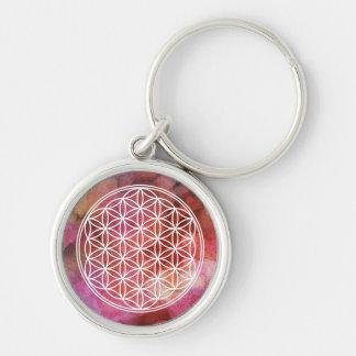 Chaveiro Flor do símbolo da vida no fundo cor-de-rosa