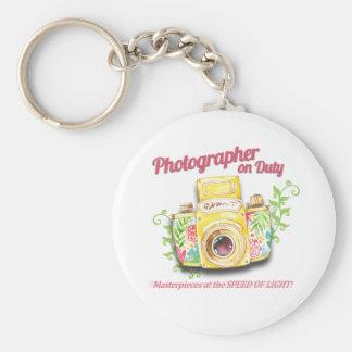 Chaveiro Fotógrafo no design da câmera do vintage do dever